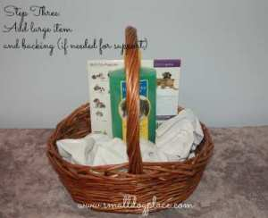 Puppy Gift Basket:  Add largest items first