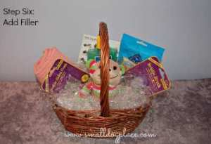Add filler or paper shred to your puppy gift basket