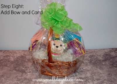 To finish off your puppy gift basket, add a bow and card.