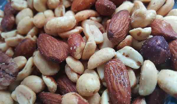 To be safe, don't feed nuts to your dog.
