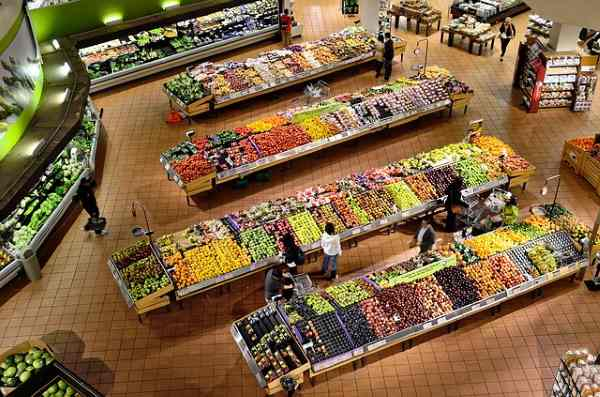 Looking down on a large produce section of a grocery or supermarket.